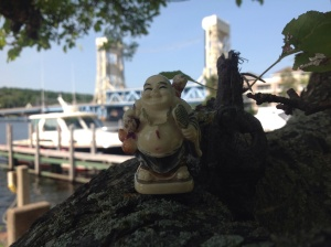 Leading free yoga practices every Saturday at my local marina  allows me to imagine a merry cast of characters for my novel in progress because usually it's just Siddhartha (aka Buddha), me and the apple tree meditating for humankind.