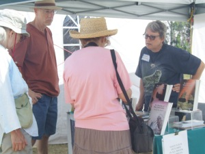 Deborah K. Frontiera chats with book browsers at the annual Eagle Harbor Art Show on the shores of Lake Superior.