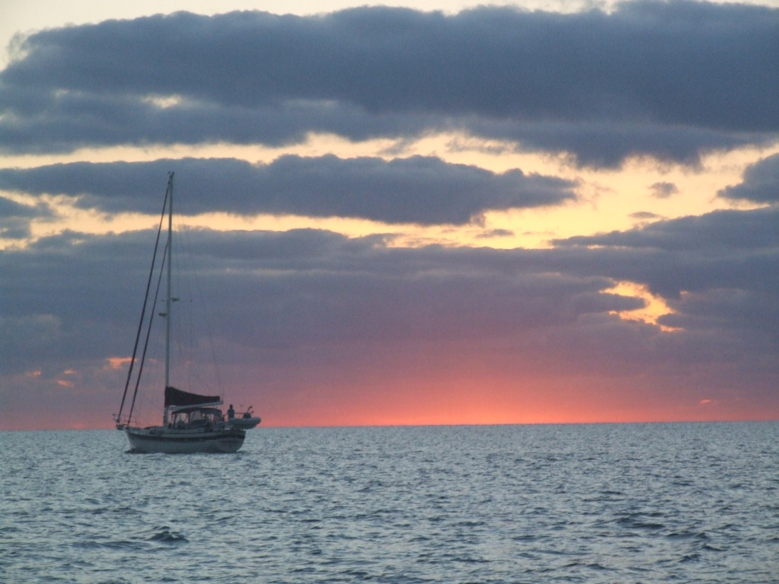 A sailboat departs from Rodriguez Key Anchorage, near Key Biscayne, at sunrise. Chip Ahoy, on her way from Marathon to Miami, and eventually Indiantown Boatyard, would soon follow.