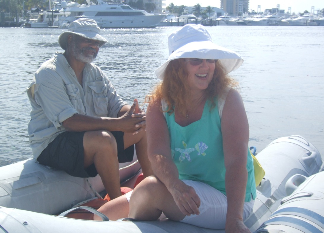 A long-time sailing couple, David and Jill, cruising in their dinghy on Las Olas Mooring field
