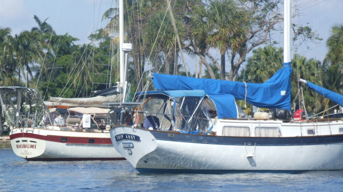 A 32-foot DownEast sailboat Chip Ahoy and a 44-foot CSY, Shibumi, moored in Fort Lauderdale's Las Olas mooring field.