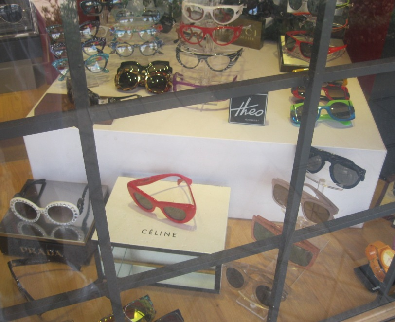 Sunnies on display in a boutique window in the vibrant downtown shopping and dining district.